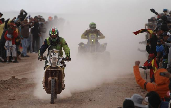 KTM rider Brett Cummings of South Africa, left, and Yamaha rider Ignacio Casale of Chile race during the seventh stage of the Dakar Rally between the cities of Salta, Argentina and Uyuni, Bolivia, Sunday, Jan. 12, 2014.