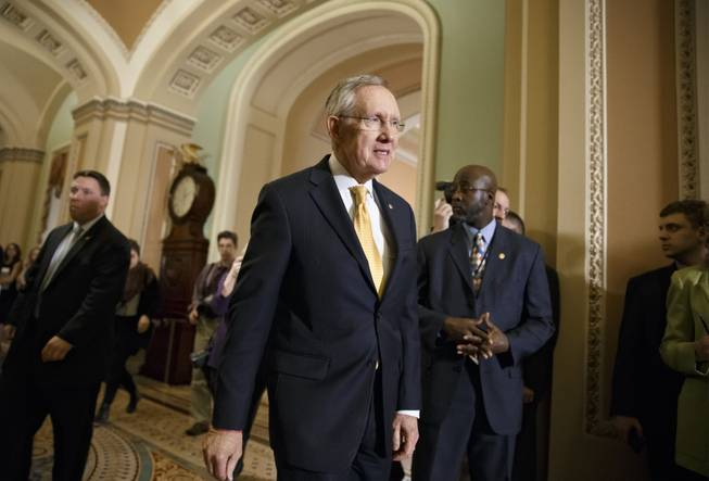 Senate Majority Leader Harry Reid, D-Nev., walks to meet with reporters following a Democratic policy luncheon at the Capitol in Washington, Tuesday, Jan. 14, 2014.