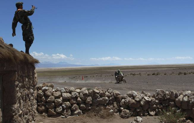 KTM rider Brett Cummings of South Africa races during the eighth stage of the Dakar Rally between the cities Uyuni, Bolivia and Calama, Chile in Kui, Bolivia, Monday, Jan. 13, 2014.
