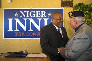 Republican Niger Innis, left, talks with Ret. Air Force Col. Bob Frank after announcing he is running for Congress at Leticia's Cocina, a Mexican restaurant near Highway 95 and Durango Dr., Wednesday, Jan. 15, 2014. Innis will challenge Democrat Steven Horsford for the seat.