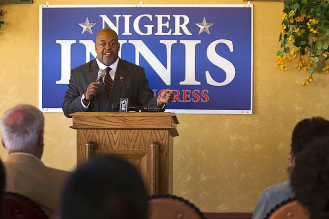 Republican Niger Innis responds to a reporter's question after announcing he is running for Congress at Leticia's Cocina, a Mexican restaurant near Highway 95 and Durango Dr., Wednesday, Jan. 15, 2014. Innis will challenge Democrat Steven Horsford for the seat.