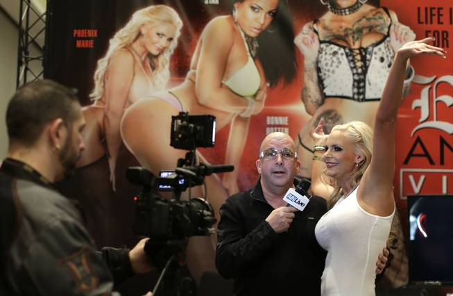 Porn star Phoenix Marie does an interview with the Adult Video Network during the Adult Entertainment Expo, Wednesday, Jan. 15, 2014, in Las Vegas. Potential opportunities for X-rated film production in Nevada were the talk of the Expo at the Hard Rock hotel and casino this week, sparked by a Los Angeles law requiring male actors to wear condoms.