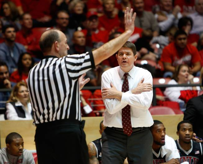 UNLV's head coach Dave Rice reacts to a call from the official in the first half of an NCAA college basketball game Wednesday, Jan. 15, 2014 in Albuquerque, N.M. UNLV won 76-73.