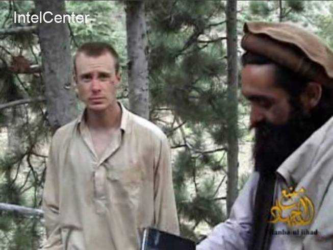 This file image provided by IntelCenter on Wednesday Dec. 8, 2010, shows a framegrab from a video released by the Taliban containing footage of a man believed to be Sgt. Bowe Bergdahl, left.