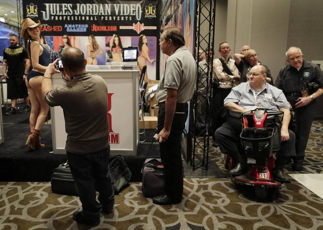 Porn industry affiliates and fans wait in line for an autograph from porn star Riley Reid at the Adult Entertainment Expo, Wednesday, Jan. 15, 2014, in Las Vegas. Potential opportunities for X-rated film production in Nevada were the talk of the Expo at the Hard Rock hotel and casino this week, sparked by a Los Angeles law requiring male actors to wear condoms.