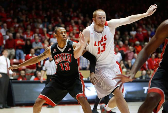 New Mexico's Alex Kirk, right, and UNLV's Bryce Dejean-Jones battle for position Wednesday, Jan. 15, 2014, in Albuquerque. UNLV won 76-73.