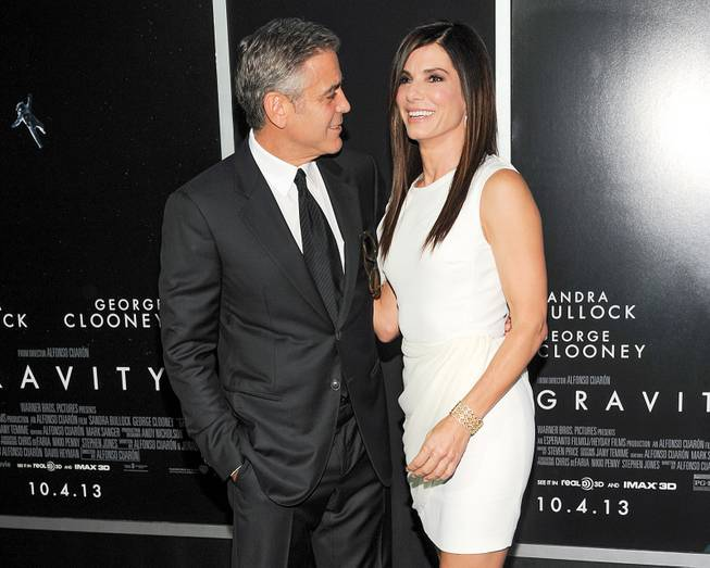 "George Clooney and Sandra Bullock attend the premiere of ""Gravity"" at the AMC Lincoln Square Theaters on Tuesday, Oct. 1, 2013, in New York."