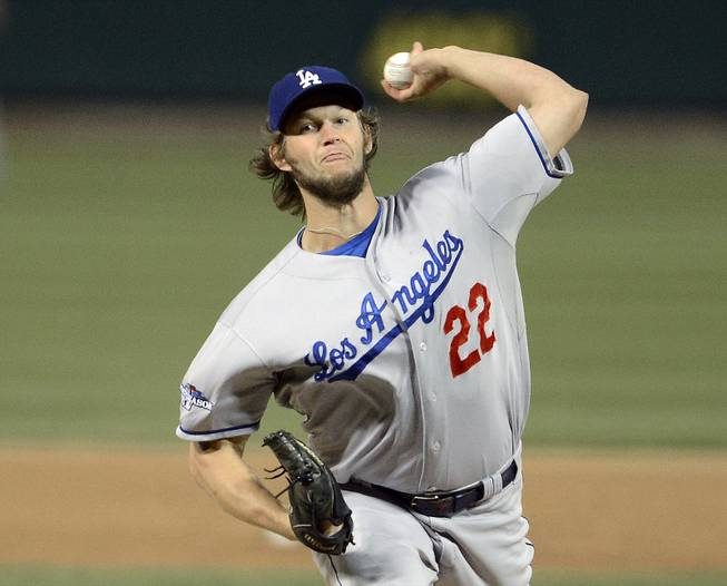 Los Angeles Dodgers starting pitcher Clayton Kershaw throws during the first inning of Game 6 of the National League baseball championship series against the St. Louis Cardinals, Friday, Oct. 18, 2013, in St. Louis.