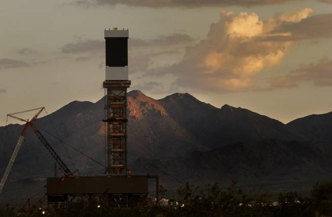 The sun sets behind one of three Solar Receivers at BrightSource Energy's Ivanpah Solar Electric Generating Station (ISEGS) in California's Ivanpah Valley, just miles south of the Nevada state line Aug. 8, 2012.