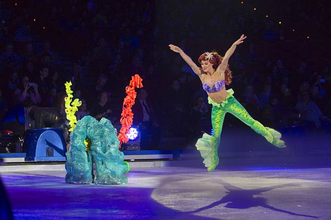 "Ariel from ""The Little Mermaid"" jumps during ""Disney On Ice: Rockin' Ever After"" at the Thomas & Mack Center Thursday, Jan. 16, 2014. The show plays at the center through Sunday."