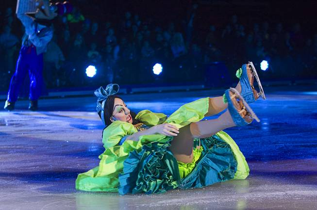 "One of Cinderella's ugly stepsisters slides on the ice after falling during ""Disney On Ice: Rockin' Ever After"" at the Thomas & Mack Center Thursday, Jan. 16, 2014. The show plays at the center through Sunday."