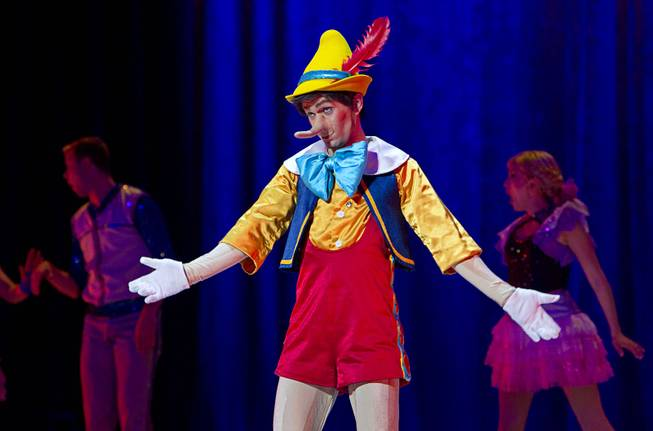 "Pinnochio's noise grows after he tells a lie during ""Disney On Ice: Rockin' Ever After"" at the Thomas & Mack Center Thursday, Jan. 16, 2014. The show plays at the center through Sunday."