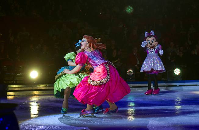 "Cinderella's ugly stepsisters collide during ""Disney On Ice: Rockin' Ever After"" at the Thomas & Mack Center Thursday, Jan. 16, 2014. The show plays at the center through Sunday."