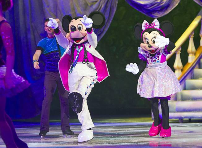 "Mickie Mouse and Minnie Mouse arrive for an opening number during ""Disney On Ice: Rockin' Ever After"" at the Thomas & Mack Center Thursday, Jan. 16, 2014. The show plays at the center through Sunday."