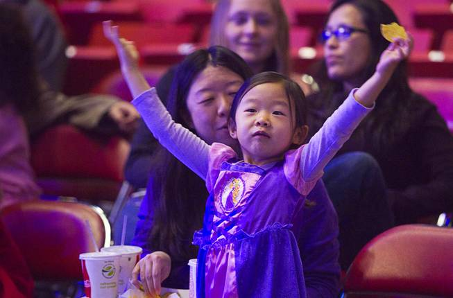 "Isabelle Kim, 5, waits for the start of ""Disney On Ice: Rockin' Ever After"" at the Thomas & Mack Center Thursday, Jan. 16, 2014. The show plays at the center through Sunday."