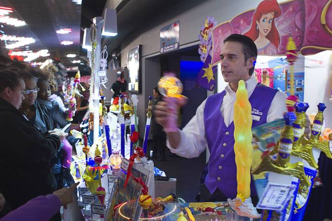 "Darren Maiale sells Disney merchandise and spinning toys before the ""Disney On Ice: Rockin' Ever After"" show at the Thomas & Mack Center Thursday, Jan. 16, 2014. The show plays at the center through Sunday."