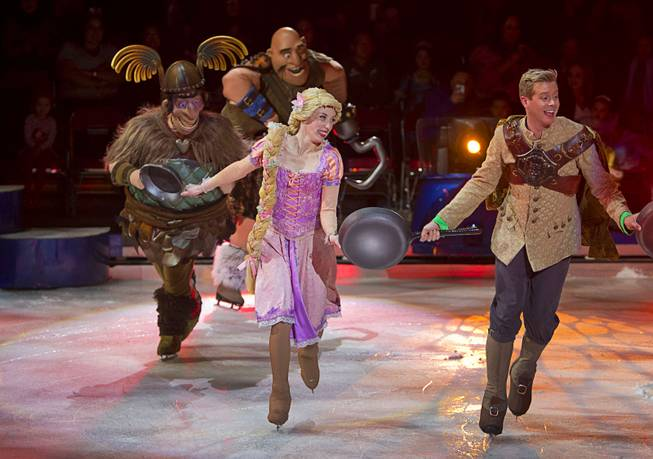 "Rapunzel from ""Tangled"" skates with ruffians as they perform to the song ""I Have a Dream"" during ""Disney On Ice: Rockin' Ever After"" at the Thomas & Mack Center Thursday, Jan. 16, 2014. The show plays at the center through Sunday."