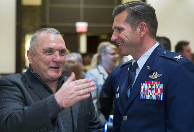 Inspirational speaker Rudy Ruettiger speaks with Air Force Col. Barry Cornish, 99th Air Base Wing Commander at Nellis Air Force Base, after the North Las Vegas State of the City Address at Aliante Casino in North Las Vegas, Jan. 16, 2014.