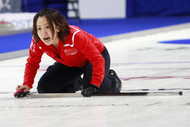 Satsuki Fujisawa yells instructions to her sweepers during the first day of the 2014 World Financial Group Continental Cup of Curling at the Orleans Arena Thursday, Jan. 16, 2014. Of the twelve teams competing from around the world, nine of them will represent their respective country at the upcoming Olympics in Sochi, Russia.