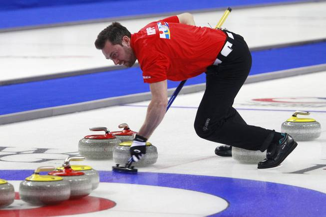 Sebastian Kraupp sweeps in front of a stone during the first day of the 2014 World Financial Group Continental Cup of Curling at the Orleans Arena Thursday, Jan. 16, 2014. Of the twelve teams competing from around the world, nine of them will represent their respective country at the upcoming Olympics in Sochi, Russia.