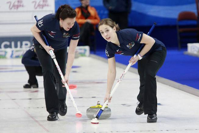 Ann Swisshelm, left, and Jessica Schultz sweep in front of their stone during the first day of the 2014 World Financial Group Continental Cup of Curling at the Orleans Arena Thursday, Jan. 16, 2014. Of the twelve teams competing from around the world, nine of them will represent their respective country at the upcoming Olympics in Sochi, Russia.