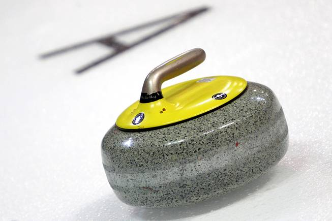 A curling stone is rests on the ice during the first day of the 2014 World Financial Group Continental Cup of Curling at the Orleans Arena Thursday, Jan. 16, 2014. Of the twelve teams competing from around the world, nine of them will represent their respective country at the upcoming Olympics in Sochi, Russia.