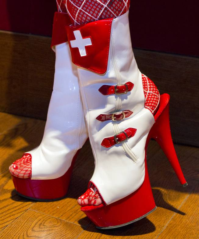 Leather red cross shoes are worn for the AVN Adult Entertainment Expo happening at the Hard Rock Hotel & Casino on Thursday , Jan. 16, 2014.