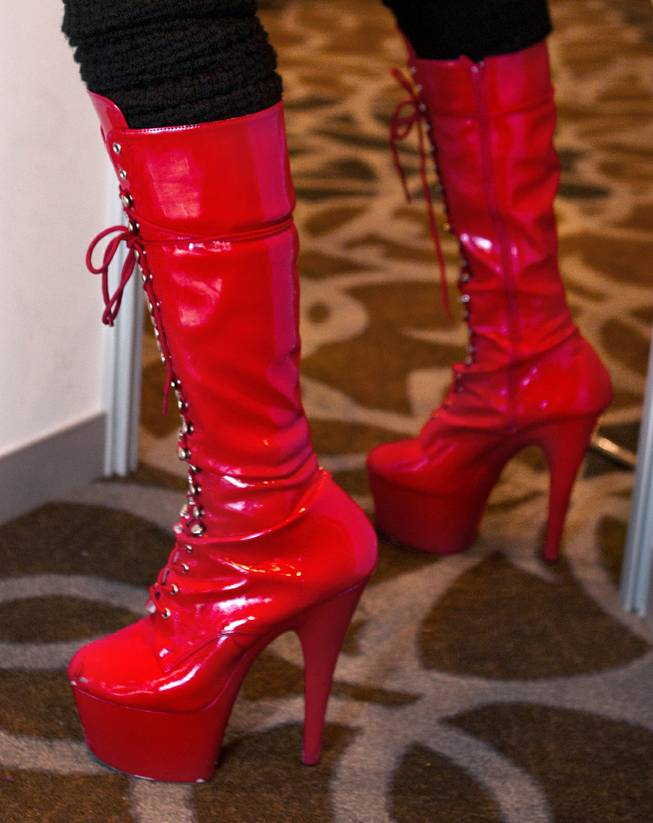 Red leather and laced high heel shoes are worn for the AVN Adult Entertainment Expo happening at the Hard Rock Hotel & Casino on Thursday , Jan. 16, 2014.