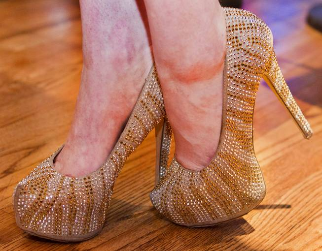 Gold and glittery shoes are worn for the AVN Adult Entertainment Expo happening at the Hard Rock Hotel & Casino on Thursday , Jan. 16, 2014.