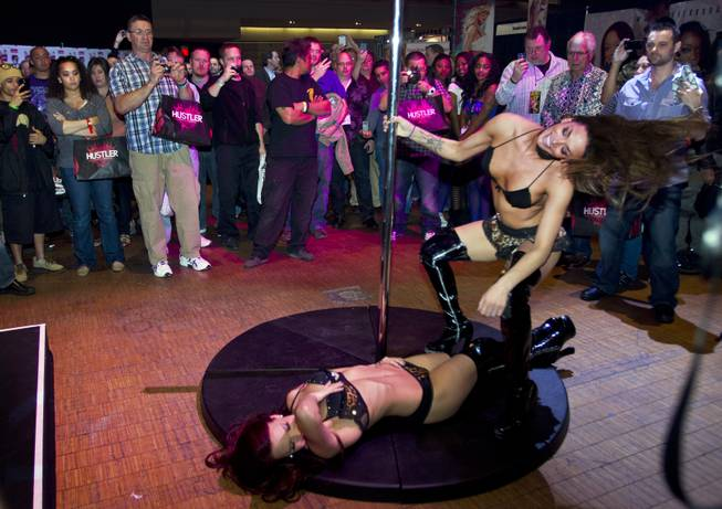 Performers with the X Burlesque dance show entertain the crowd during the AVN Adult Entertainment Expo  on Thursday, Jan. 16, 2014.