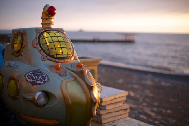 In this photo taken on Thursday, Nov. 28, 2013, a submarine from an amusement arcade is on the beach in central Sochi, Russia.