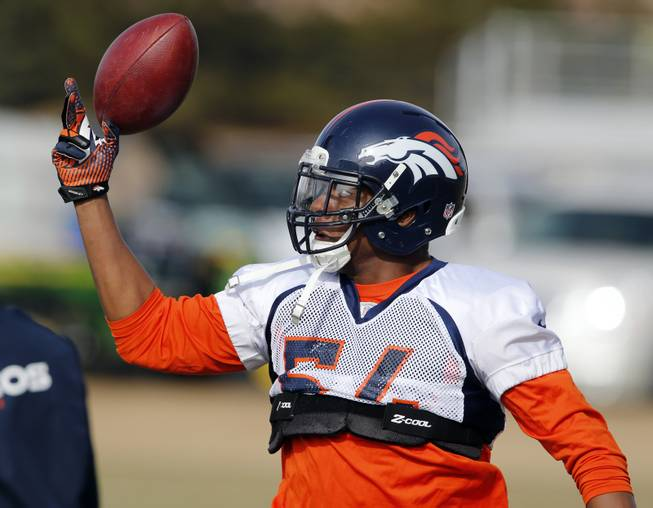 Denver Broncos linebacker Brandon Marshall reaches for a football during practice at the team's training facility in Englewood, Colo., on Jan. 16, 2014. The Broncos will play the Seattle Seahawks on Feb. 2 in Super Bowl 48.