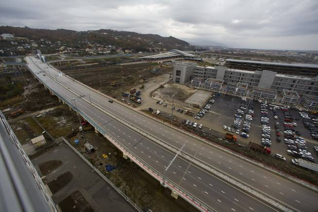 In this photo taken on Wednesday, Nov. 27, 2013,  a new highway is seen on the fringes of the Olympic park in Sochi, Russia.