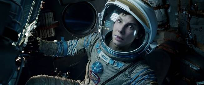 "This film image released by Warner Bros. Pictures shows Sandra Bullock in a scene from ""Gravity."" The film was nominated for an Academy Award for best picture on Thursday, Jan. 16, 2014. The 86th Academy Awards will be held on March 2."