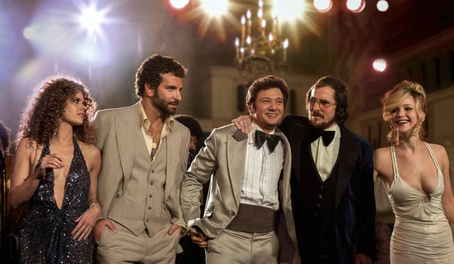 "Amy Adams, Bradley Cooper, Jeremy Renner, Christian Bale and Jennifer Lawrence star in ""American Hustle."""