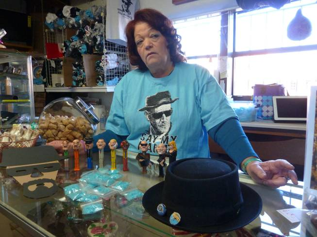 "Debbie Ball, known locally as ""The Candy Lady,"" poses with ""Breaking Bad"" kitsch she sells in her store, including candy made to look like blue meth crystals, Jan. 16, 2014, in Albuquerque."