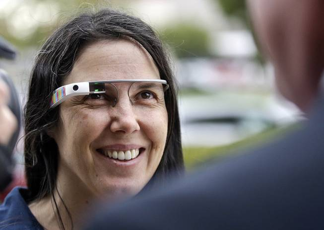 Cecilia Abadie wears her Google Glass as she talks with her attorney outside of traffic court in this Dec. 3, 2013, file photo taken in San Diego.