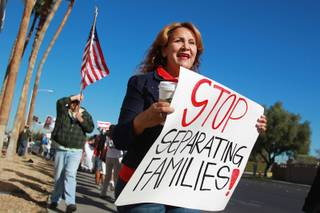 Picketers protest U.S. House Speaker John Boehner as he makes a fundraising appearance for Nevada Rep. Joe Heck at the Las Vegas Country Club Friday, Jan. 17, 2014.