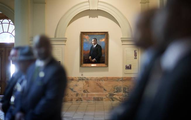 A portrait of Rev. Martin Luther King, Jr., hangs in the hallway of the State Capitol during a ceremony paying tribute to King Jr., Friday, Jan. 17, 2014, in Atlanta. The national Dr. Martin Luther King Jr. federal holiday this year is Monday, Jan. 20, five days after the civil rights leader would have turned 85-years-old.