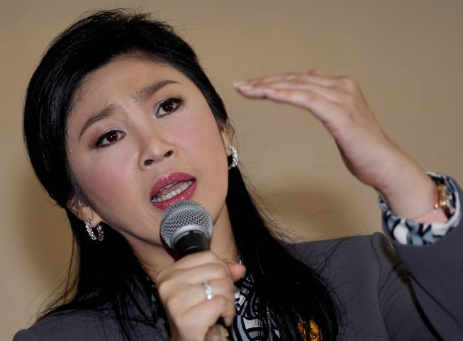 In this Jan. 17, 2014 file photo, Thai Prime Minister Yingluck Shinawatra gestures as she answers questions during an interview with the foreign media at the office of Permanent Secretary for Defense on the outskirts of Bangkok, Thailand.