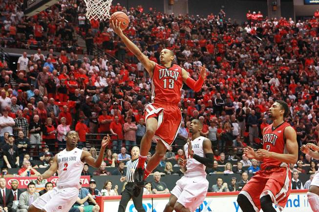 UNLV guard Bryce Dejean Jones drives in for an open layup, and misses, against SDSU during their game Saturday, Jan. 18, 2014 at Viejas Arena in San Diego.
