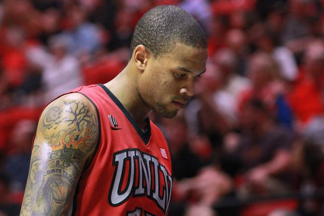 UNLV guard Bryce Dejan Jones heads to the bench after being pulled late in their game against San Diego State Saturday, Jan. 18, 2014 at Viejas Arena in San Diego. Dejean Jones shot 7 for 25 and the 10th ranked SDSU won the game 63-52.