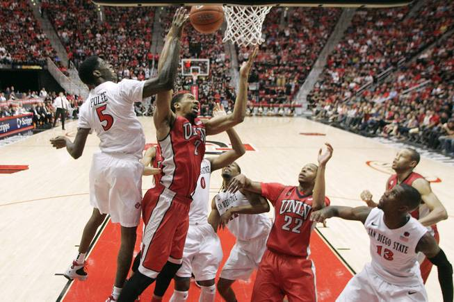 UNLV forward Khem Birch and San Diego State forward Dwayne Polee fight for a rebound during their game Saturday, Jan. 18, 2014 at Viejas Arena in San Diego. The 10th ranked SDSU won the game 63-52.