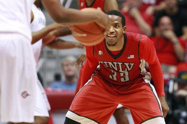 UNLV guard Deville Smith gets set to defend San Diego State during their game Saturday, Jan. 18, 2014, at Viejas Arena in San Diego. The 10th-ranked SDSU won the game 63-52.
