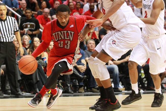 UNLV guard Deville Smith drives to the lane against San Diego State during their game Saturday, Jan. 18, 2014 at Viejas Arena in San Diego. The 10th ranked SDSU won the game 63-52.