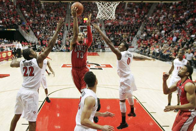 UNLV guard Bryce Dejan Jones drives to the basket, and misses, against San Diego State Saturday, Jan. 18, 2014 at Viejas Arena in San Diego. The 10th ranked SDSU won the game 63-52.