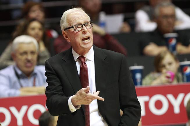 San Diego State head coach Steve Fisher talks to his team during their game against UNLV Saturday, Jan. 18, 2014 at Viejas Arena in San Diego. The 10th ranked SDSU won the game 63-52.