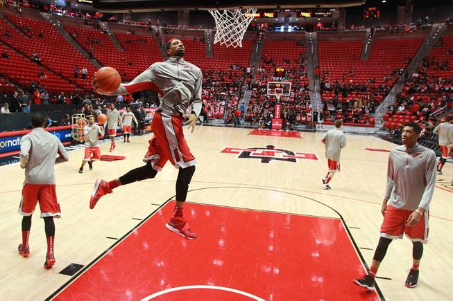 UNLV forward Khem Birch leaps toward the basket while warming up before the Rebels' game against San Diego State on Saturday, Jan. 18, 2014, at Viejas Arena in San Diego.