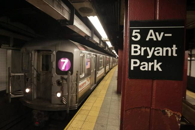 In this Dec. 4, 2013, photo, a No. 7 New York City subway train arrives in the 5th Avenue-Bryant Park station in New York. Noise from screeching subway trains can be overwhelming, sometimes rising up out of the caverns trains operate in and into the buildings above.