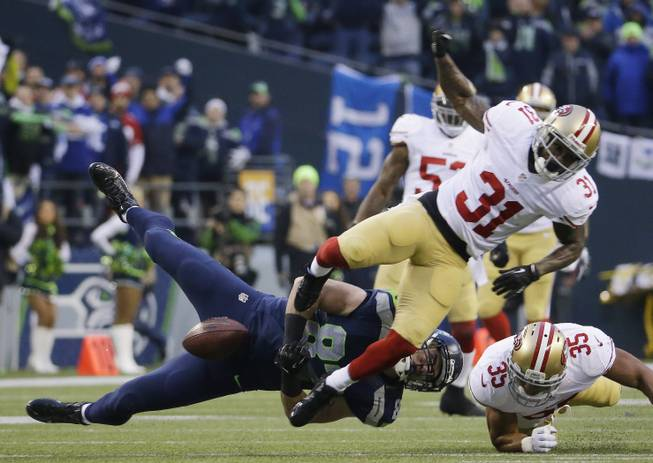 Seattle Seahawks' Luke Willson can't catch a pass as he is hit by San Francisco 49ers' Donte Whitner (31) during the first half of the NFL football NFC Championship game Sunday, Jan. 19, 2014, in Seattle. (AP Photo/Ted S. Warren)